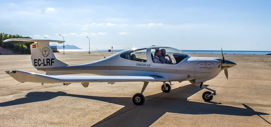 AIRCRAFT DIAMOND DA40 WAITING IN AIRPORT WITH TWO PILOTS