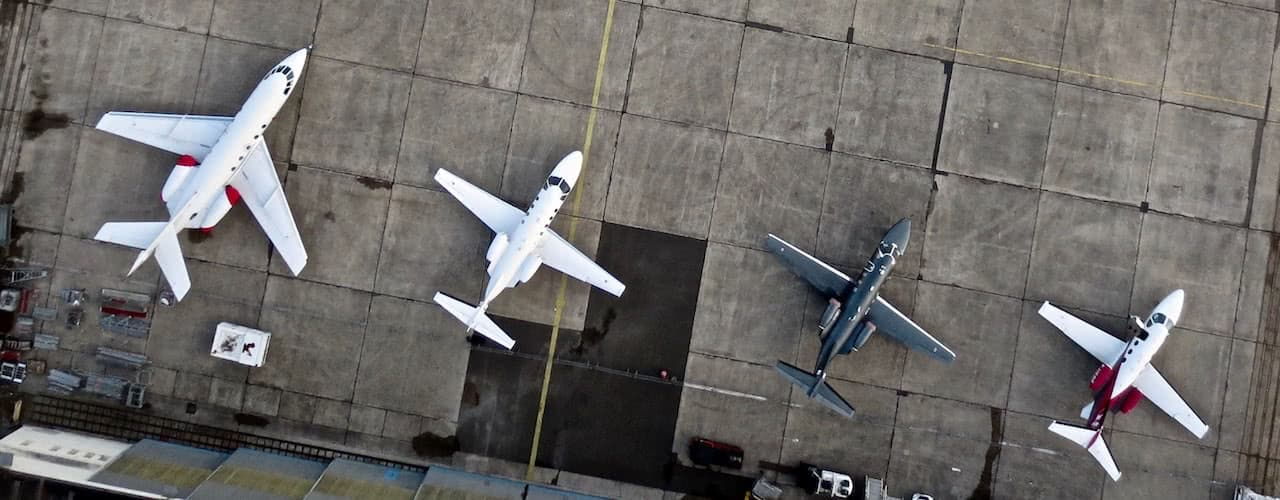 four jet aircrafts land in Airport