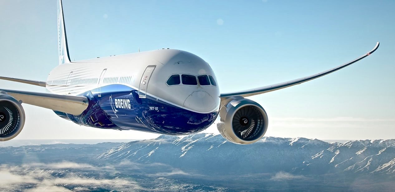 front view of the 787 boeing flying with blue sky