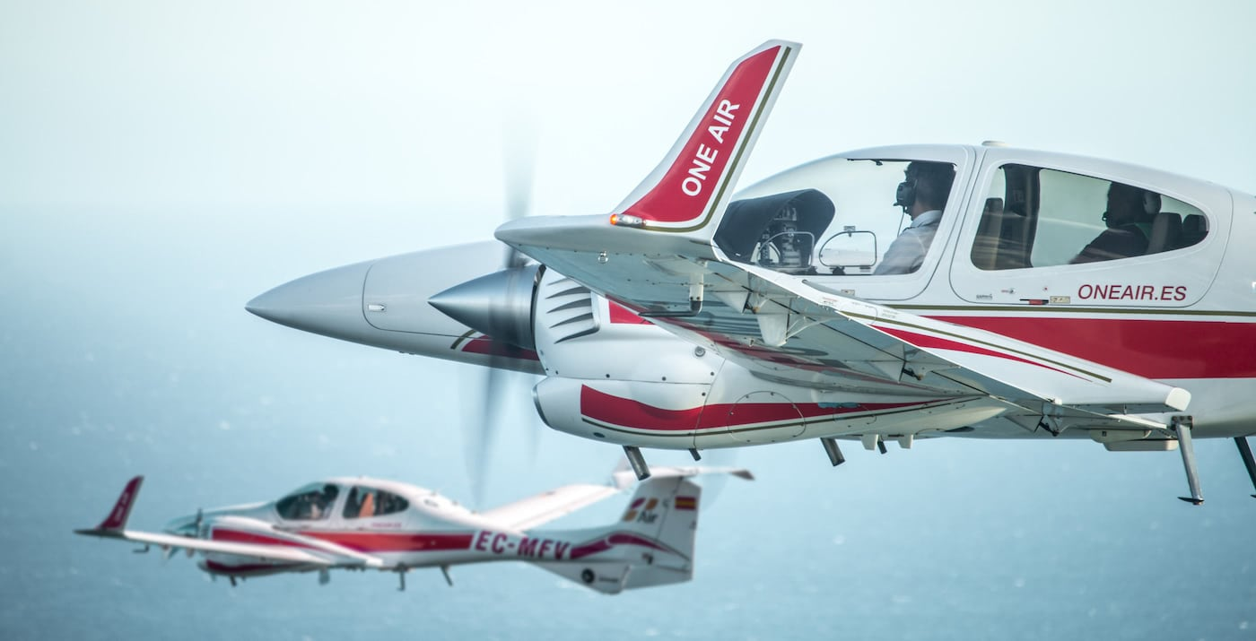 two diamond da42 aircraft of the one aviation school flying together over the sea