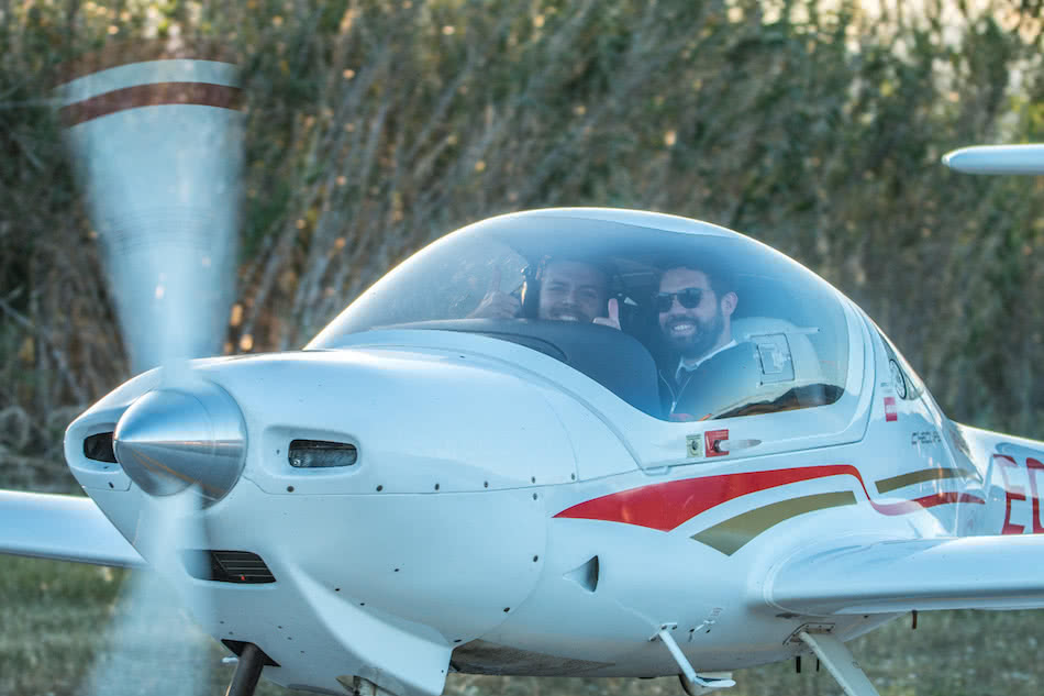 exterior view of the diamond da20 plane with a pilot instructor and a student