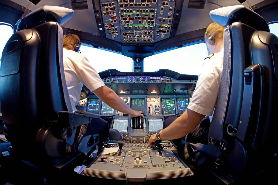 two pilot flying inside a simulator