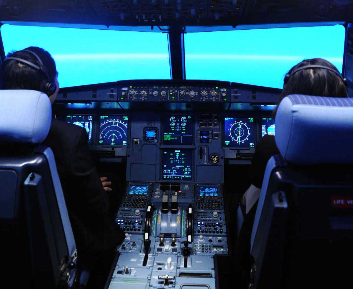 two pilots flying in a simulators cockpit