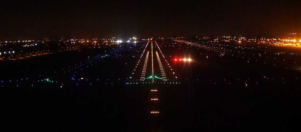 night aerial view of illuminated airstrip