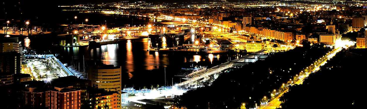 night aerial view of the port of malaga illuminated