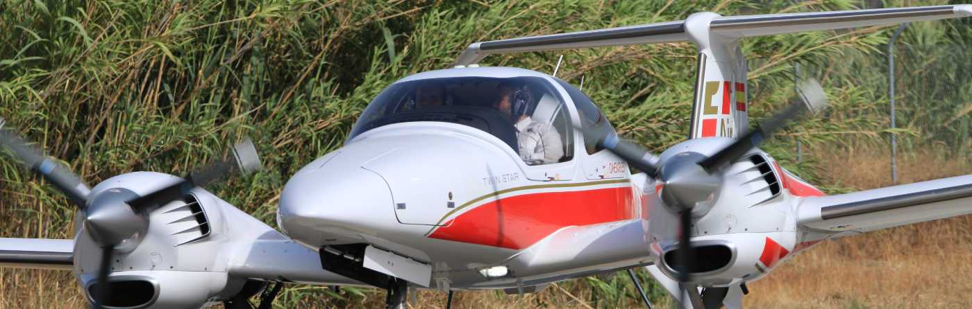 front view of a one airs diamond da42 with a pilot