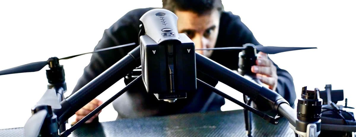 Drone pilot attaching the propellers to a DJI Inspire 2 drone