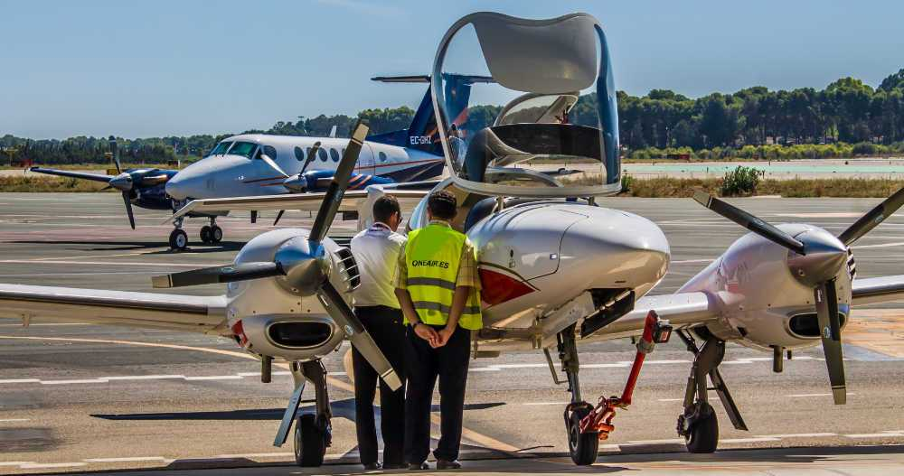 pilot and technician inspecting a one airs diamond da42 aircraft at the airport with plane in the background