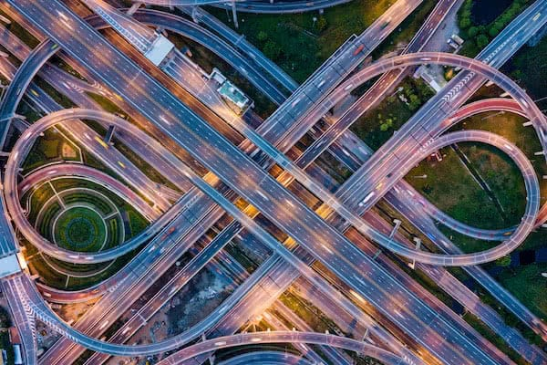 aerial view of road junction guarded with industrial drones