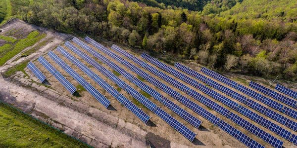 aerial view of field of solar panels for inspection with industrial drones