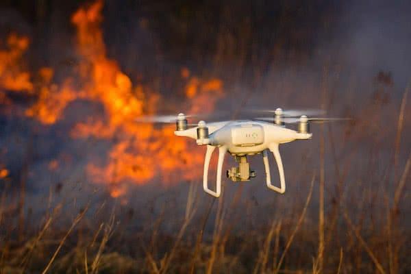 dji phantom 4 pro industrial drone flying throw the flames