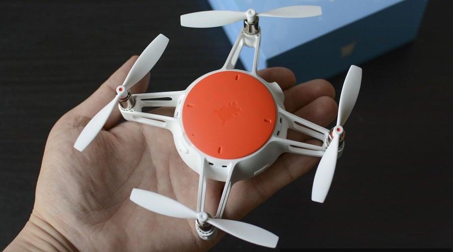 xiaomi mitu mini drone white and orange in a hand