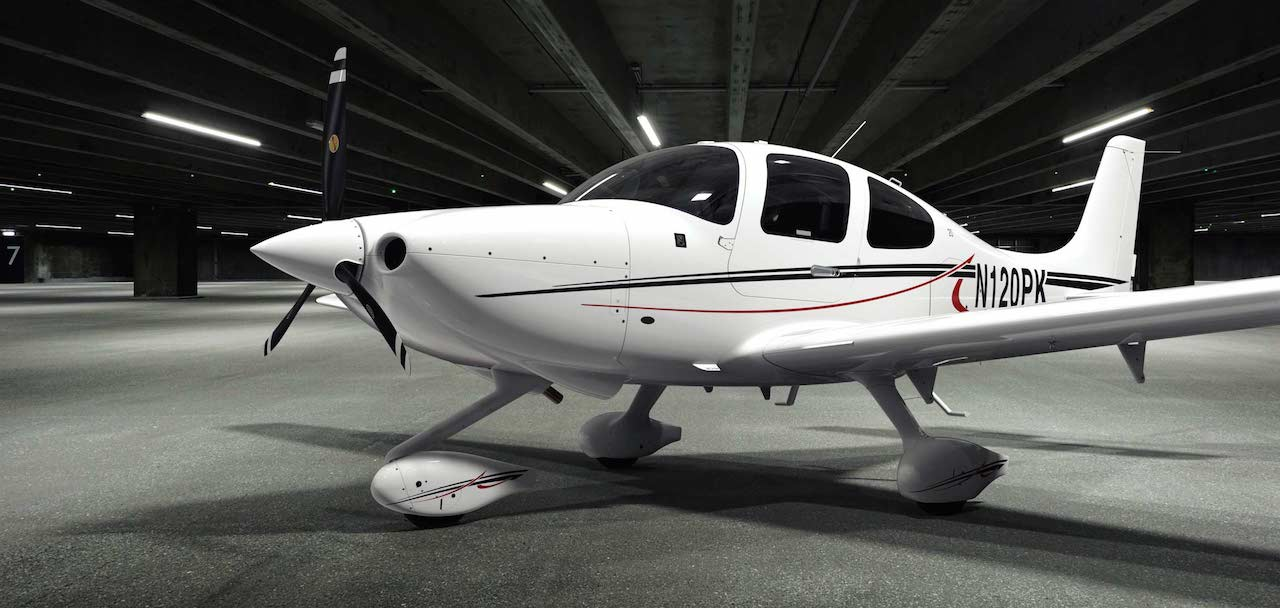 cirrus sr20 aircraft in white colour with black and red vinyls, inside a hangar