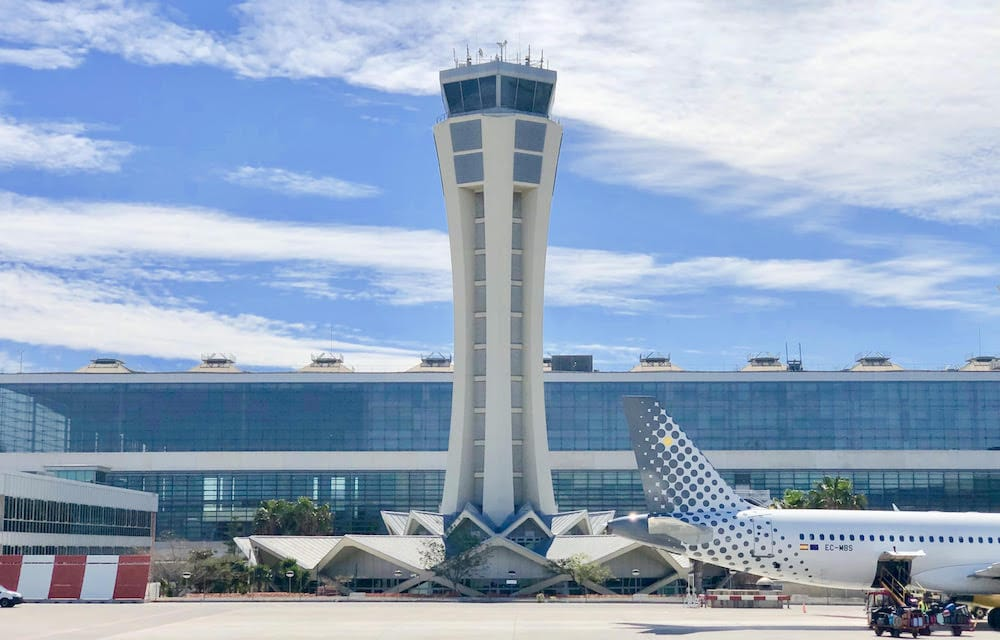 Malaga Airport control tower with the Pablo Ruiz Picasso terminal behind it.