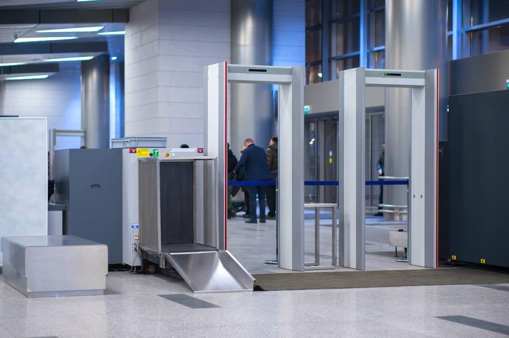 Security arcs for passengers control at Malaga Airport departures.